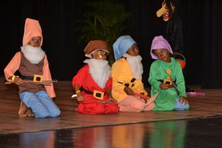 Scenes during the finals of the Children's Dance and Masquerade competition