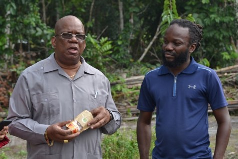 Minister of Finance, Winston Jordan with the purely dried mango.