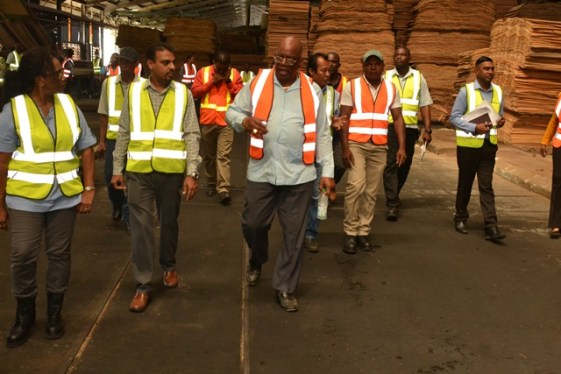 During a tour of the facility, Minister of Finance, Winston Jordan speaks with Manager, Mohindra Chan.