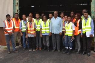 Minister of Finance, Winston Jordan with employees of Barama.