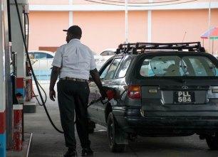GUYOIL Pump attendant selling gasoline.