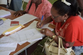 Applicants filling land title forms.