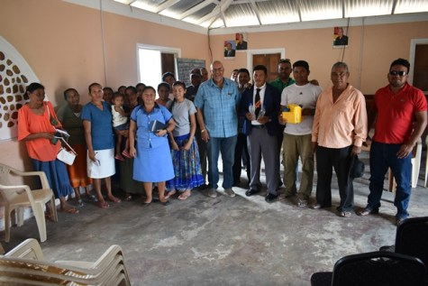 GWI officials with residents of Toka.