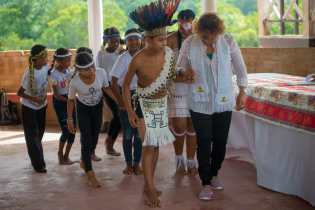 Minister Garrido-Lowe and the young people perform a traditional welcome dance
