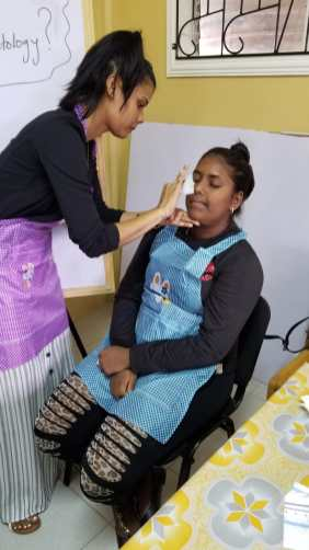 Participants involved in a practical aspect of the cosmetology course