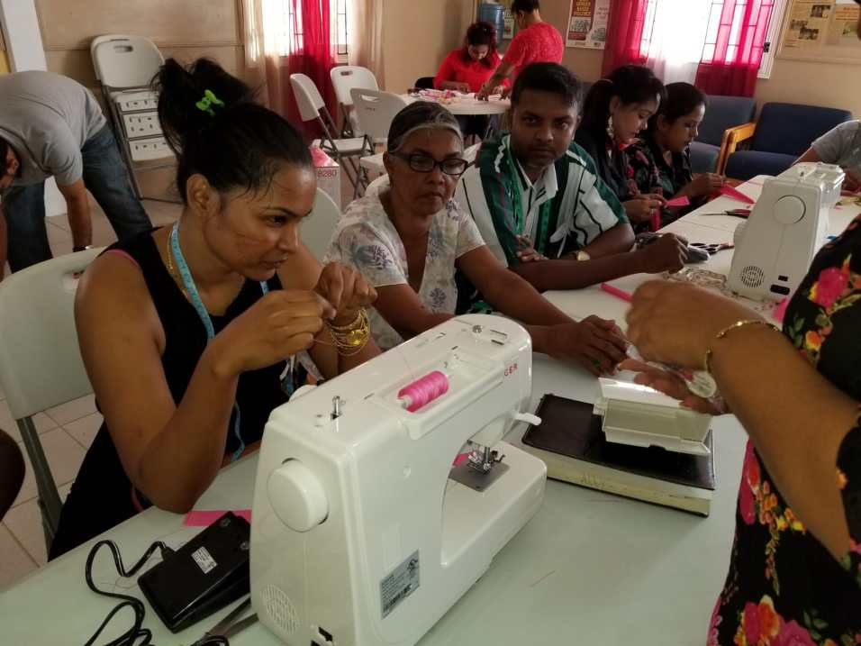 Students working during sewing class