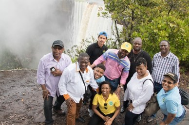 Deputy Minister of Mineral Resources of South Africa, Godfrey Oliphant, his team and the Ministry of Natural Resources staff at Kaieteur Falls.