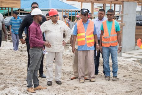 Prime Minister, Moses Nagamootoo being briefed on the progress of the rehabilitation