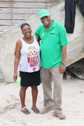 Minister of State, Joseph Harmon with a resident of Blueberry Hill