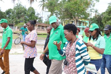 Minister of State, Joseph Harmon interacting with a nurse at the Wismar Hospital, Linden, Region 10