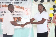 A graduate receiving a certificate from Chief Executive Officer (CEO) of the Board of Industrial Training (BIT), Richard Maughn.
