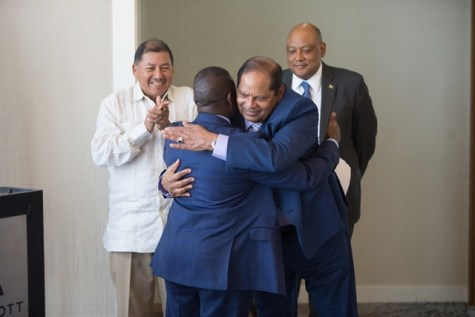 Prime Minister, Moses Nagamootoo greets South Africa's Deputy Minister of Mineral Resources, Godfrey Oliphant with a hug as Minister of Natural Resources, Raphael Trotman and Minister of Indigenous Peoples Affairs, Sydney Allicock happily looks on.