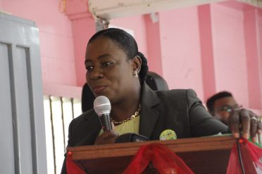 Minister of Education, Dr. the Hon. Nicolette Henry delivering remarks at the Vryman's Erven Secondary School
