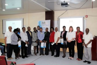 Vice-Chancellor, Professor Ivelaw Griffith and the Minister of Education, Dr. the Hon. Nicolette Henry pose with the newly installed Members of the Advisory Board along with senior members of UG's administration and the Florida International University. (Ministry of Education photo)