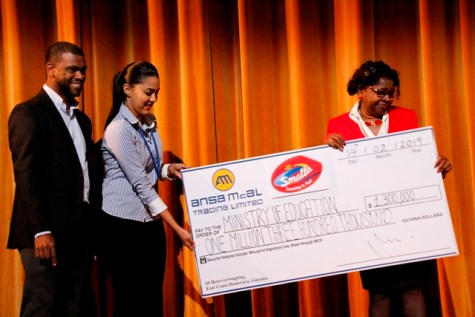 Non-Alcoholic Beverages Brand Manager of Ansa McAl, Mr. Errol Nelson and Ms. Gabriell Lopes, Smalta Marketing Assistant handing over the sponsorship cheque to Ms. Cumberbatch.