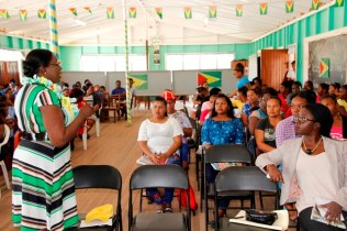 Minister of Education Dr Nicolette Henry interacting with children, teachers and parents of Ituni (Ministry of Education photo)