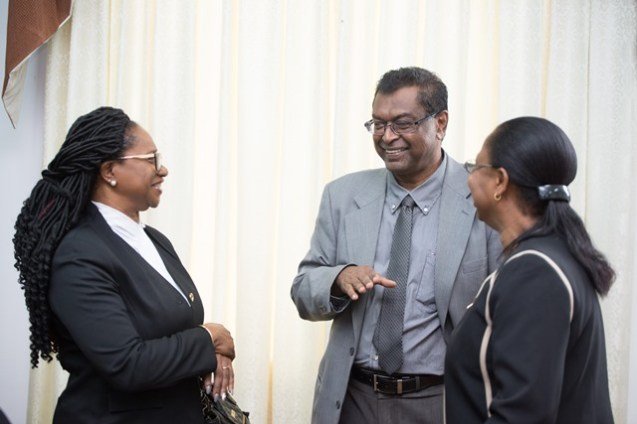 Minister of Public Security, Khemraj Ramjattan sharing a light moment with Acting Chief Justice, Roxanne George and Acting Chancellor of the Judiciary, Yonette Cummings -Edwards.