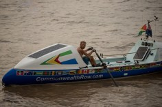 Commonwealth Rower, Richard Allen and his boat, Tamu'kke near the boathouse.