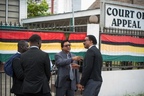 Attorney General and Minister of Legal Affairs, Basil Williams SC., interacting with Anil Nandlall and other Attorneys at Law outside of the Appeal Court.