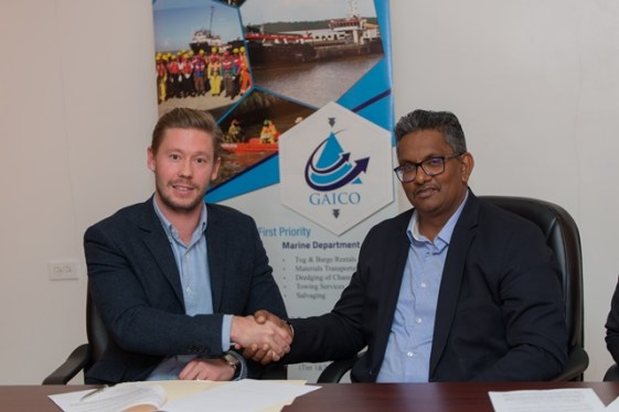 Corena Group, Development Director, Thomas Field exchanges a handshake with GAICO Construction Inc Chief Executive Officer (CEO), Komal Singh.