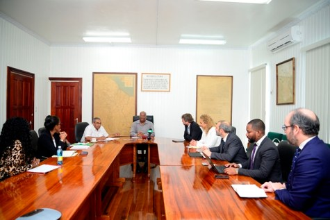 Minister of Finance, Winston Jordan with representatives of the IDB and Ministry of Finance.