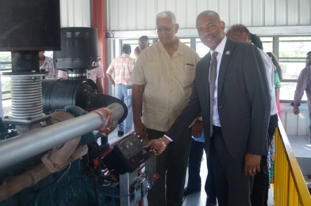 Minister Holder and CDF CEO Mr. Soomer trun the keys to power up the newly commissioned pump