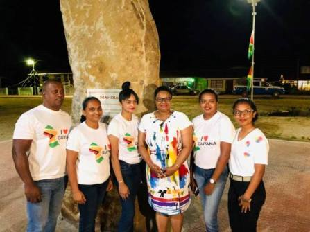 Minister of Public Health, Volda Lawrence with young members of the Mahdai township.