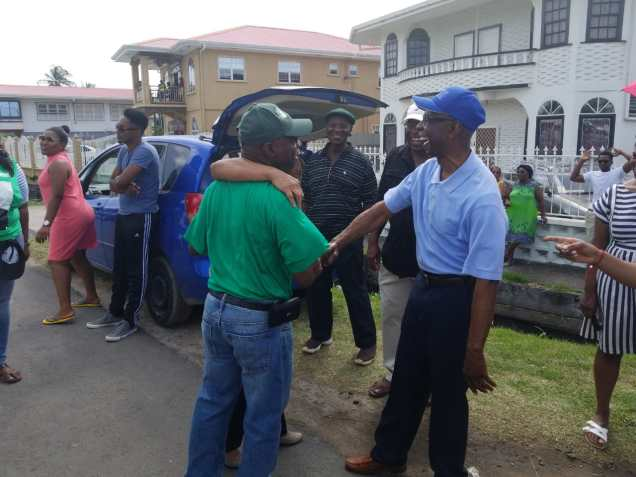 Minister of Foreign Affairs, Carl Greenidge greeting spectators along the parade route