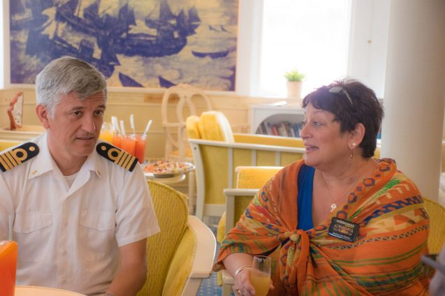 Captain Erik Juranovic chats with General Manager of Wilderness Explorers, Andrea de Caires