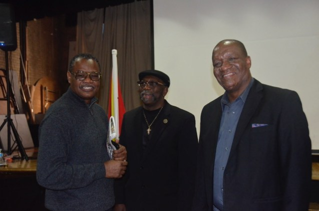 Minister of State, Mr. Joseph Harmon with two members of the Guyanese diaspora, at the St. Stephen's Church Hall, New York