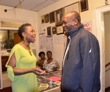 Minister of State, Mr. Joseph Harmon shares a light moment with Ms. Paula Walcott, President of The Linden Fund