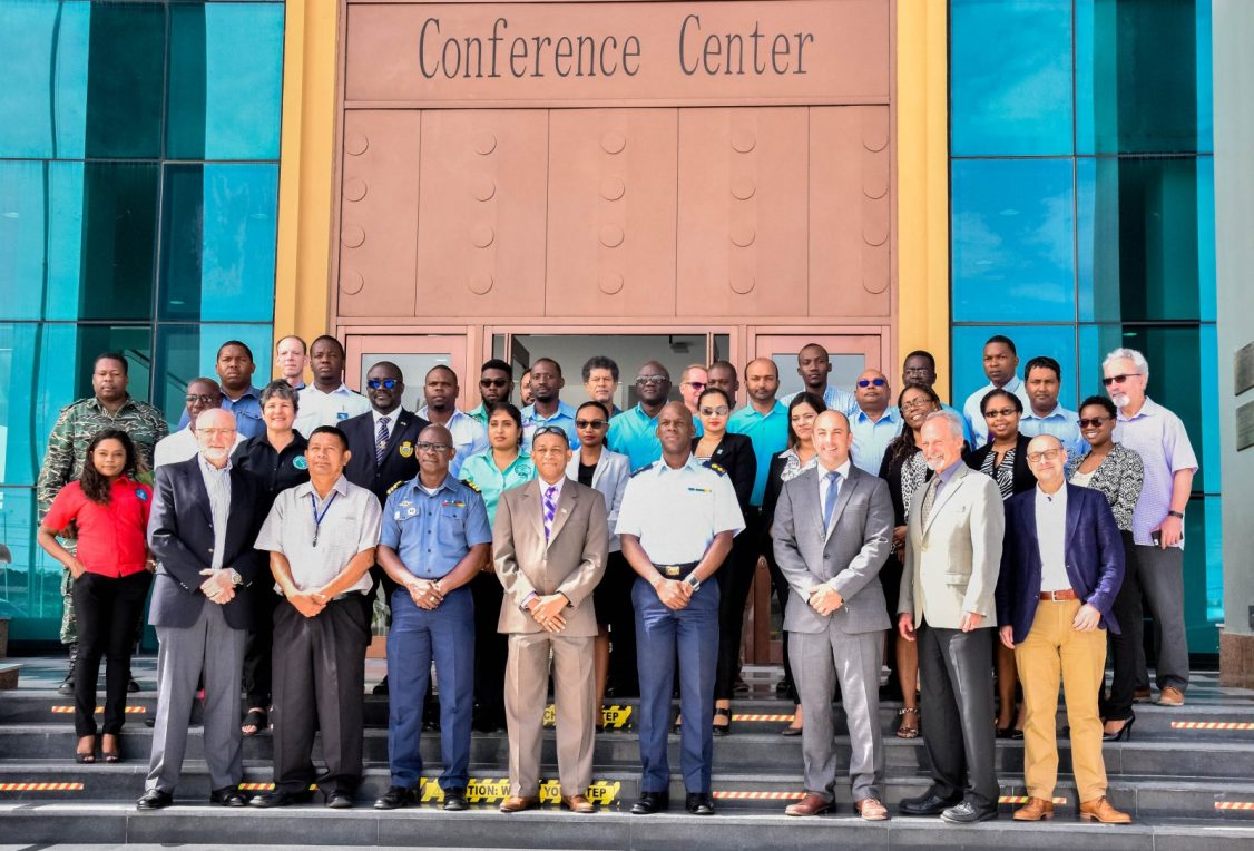 CDC's Director General (Ag.) Lieutenant Colonel Kester Craig (bottom row, fourth from right) Director of the Department of Energy, Dr. Mark Bynoe (bottom row, fifth from right) RAC/REMPEITC- Caribe, Consultant Lieutenant Commander, Matthew Richards (third from right) and International Maritime Organisation, RAC/REMPEITC- Caribe, Consultant, Dr. Elliott Taylor (second from right) among other stakeholders at the Civil Defence Commission (CDC) workshop on contingency planning and OPRC at the Arthur Chung Convention Centre, Liliendaal