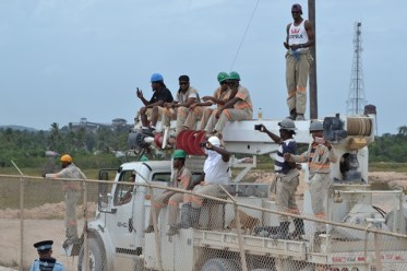Miners trying to get a glimpse of the region's Mashramani Costume and Float Parade.