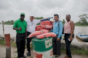 Minister of Social Cohesion, Dr. George Norton along with his team posing with Toshao
