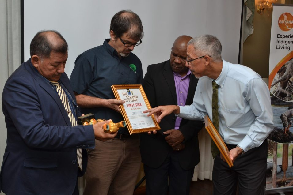 Minister of Indigenous Peoples' Affairs, Sydney Allicock, Director of the Guyana Tourism Authority, Brian Mullis, Director General of the Department of Tourism in the Ministry of Business, Donald Sinclair and Minister of Business, with responsibility for Tourism, Dominic Gaskin