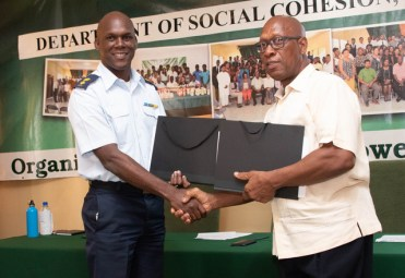 Director-General (Ag) Civil Defence Commission, Lieutenant Colonel Kester Craig (left) and Deputy Vice-Chancellor, Academic Engagement, University of Guyana, Professor Michael Scott (right) exchange agreements following a simple signing ceremony this afternoon at Camp Madewini, Timehri.