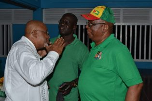 Minister of Finance, Winston Jordan interacting with a resident of South Ruimveldt