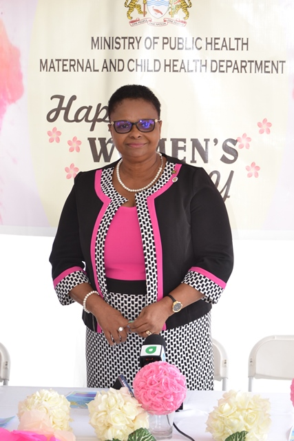 Minister Lawrence posing at IWD programme.