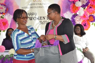 Minister Volda Lawerence handing over token to ancillary staff.