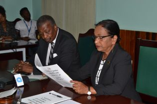Chairperson of the Indranie Chanderpal is reading parts of the report for the Speaker of the House, Dr. Barton Scotland