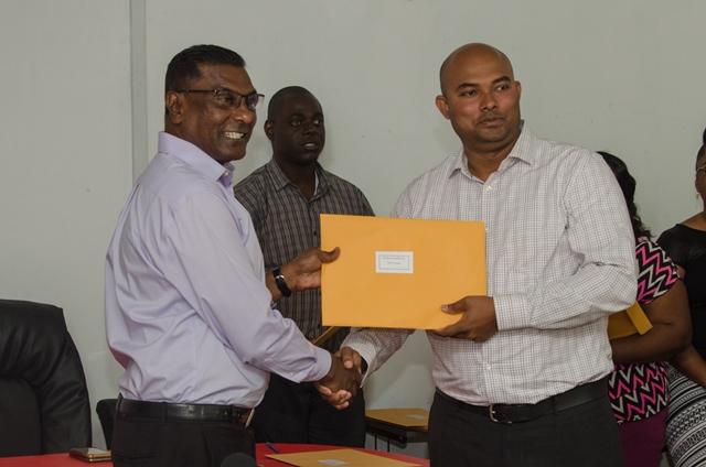 Dr. Vivakanand from Demerara Paradise Inc receiving facility license.