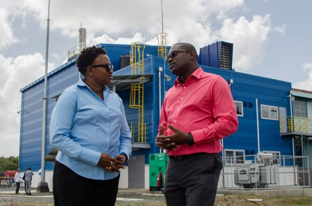 (from left to right) Minister Annette Ferguson, Minister David Patterson have a light conversation outside of the facility.