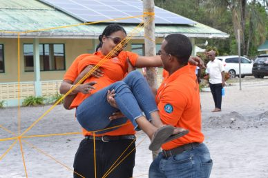 Volunteers engaging in a team building exercise