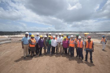Minister of Natural Resources, Raphael Trotman and South Africa's Deputy Minister of Mineral Resources, Godfrey Oliphant, his delegation, staff of the Ministry of Natural Resources with the management and some workers of Bosai Minerals Group Guyana Inc.