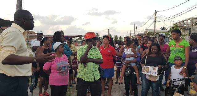 Minister of Public Infrastructure, David Patterson engages with residents of North Sophia.