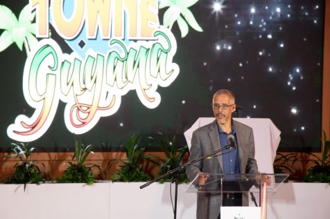 Minister of Business, Dominic Gaskin addressing the gathering at the opening of Movietowne Guyana