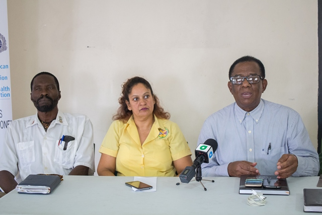 [From left to right in photo] Pres. Minibus Union, Eon Andrews, Coordinator of the GNRSC, Romona Doorgen and Chairman of GNRSC Earl Lambert.