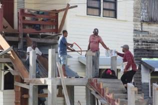 Men at a construction site sensitised about future community enhancement.