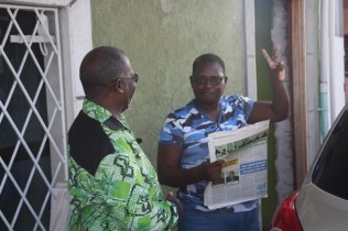 A resident of D'Urban Street, Georgetown interacting with a member of the APNU+AFC Coalition.