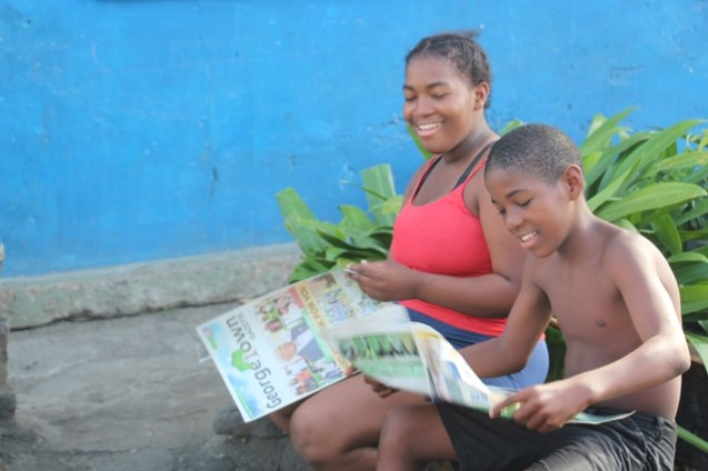 Mother and son, reviewing the information provided to them by the team visiting the area.
